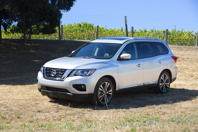 2017 Nissan Pathfinder parked in a grassy field