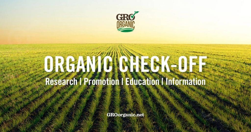a field of plants with title text reading Organic Check-Off