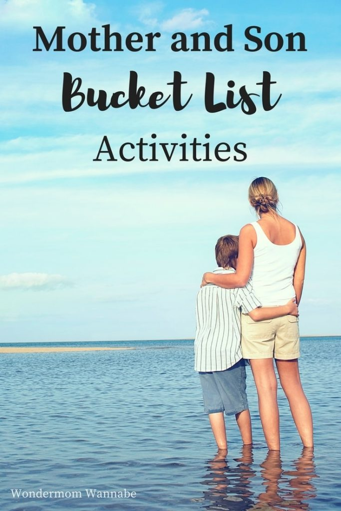 a mother and son standing with their arms around each other in the ocean looking out at the water and blue sky with title text reading Mother and Son Bucket List Activities