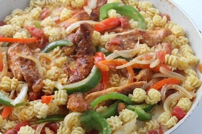 pasta, vegetables, chicken in a dish