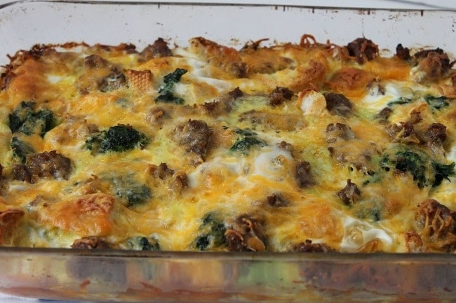 sausage and spinach strata in a glass dish