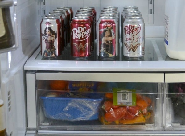 refrigerator shelves with Dr. Pepper on it in Wonder Woman packaging