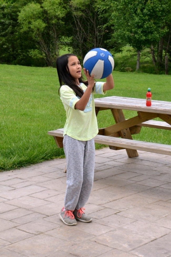a girl getting ready to shoot a basketball outside