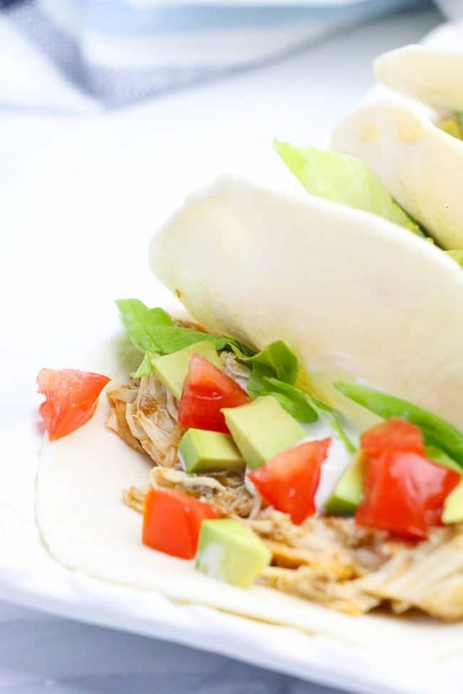 a close up of Instant Pot Salsa Verde Chicken Tacos on a white tray