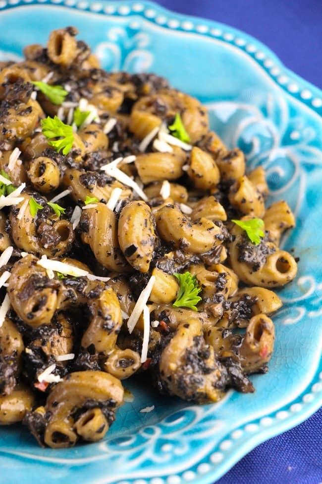 mushroom pasta on a blue plate