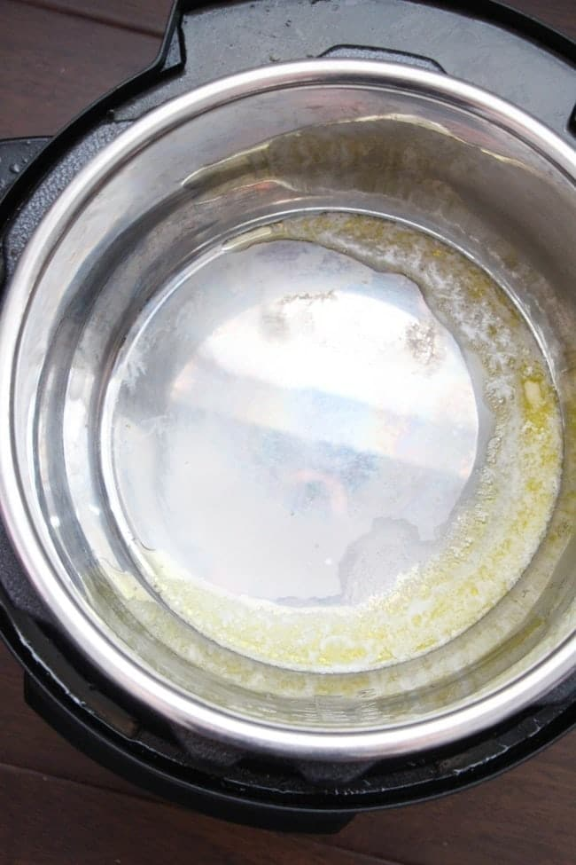 butter and garlic cooking in an instant pot