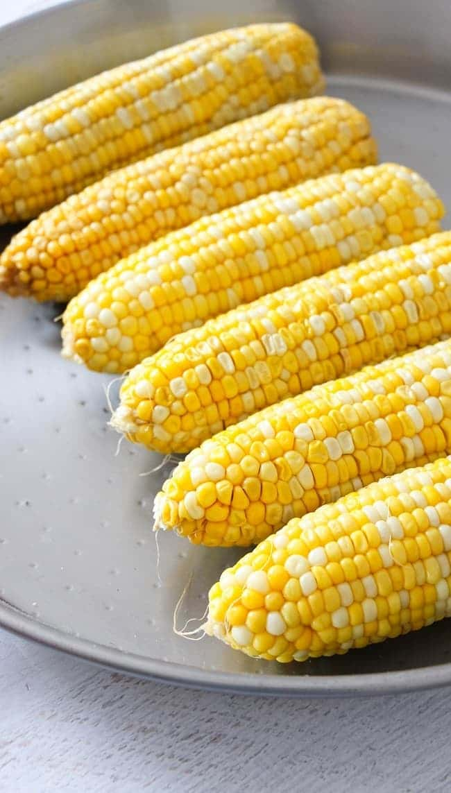 corn on the cob on a metal dish