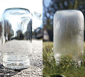 an upside down glass jar on a pavement and a jar in the grass