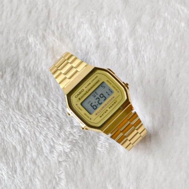 gold vintage watch on a white background