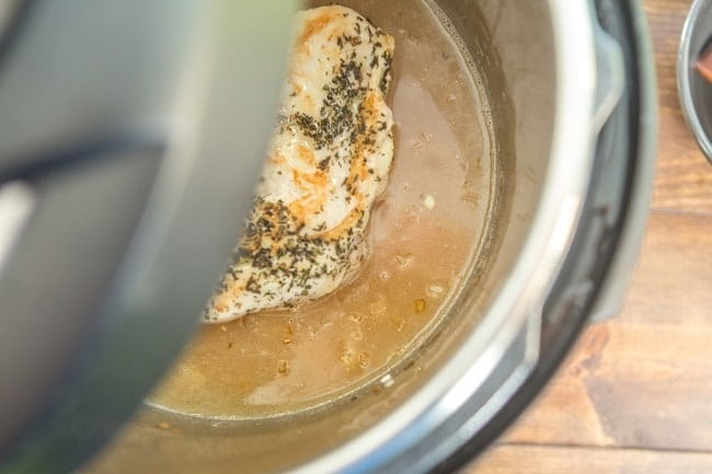 chicken and broth in an instant pot