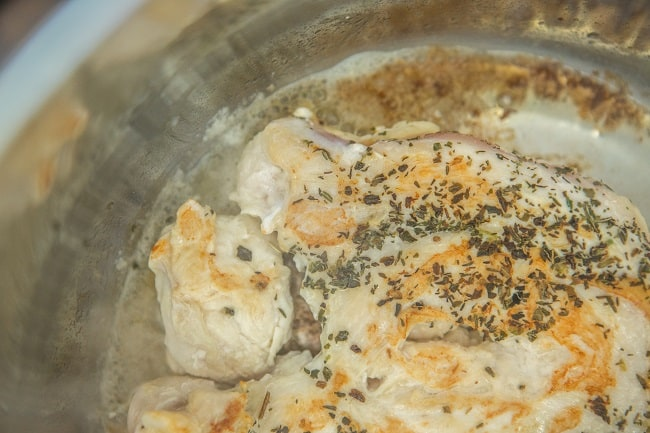 chicken being browned in butter in an instant pot