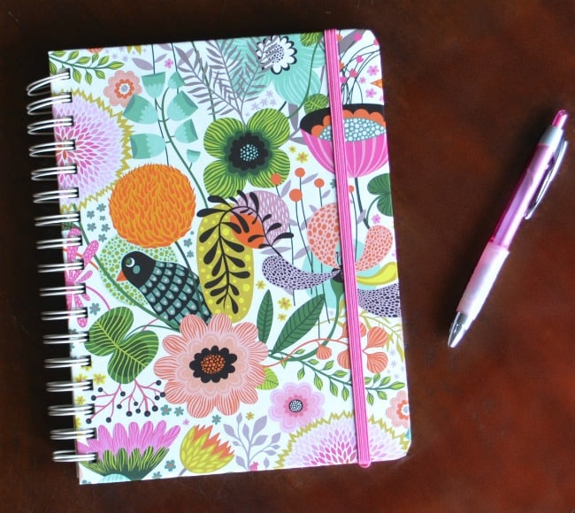 a planner with colorful flowers and a bird on the cover