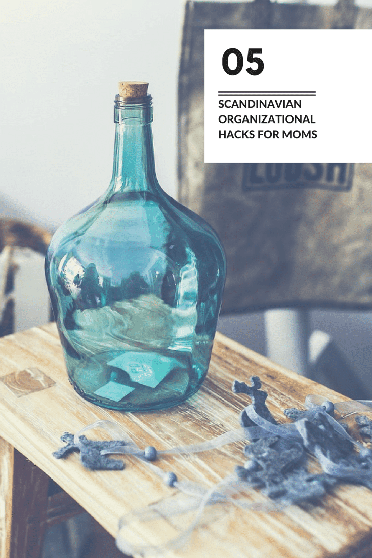 a glass jar on a table with title text reading 5 Scandinavian Organizational Hacks for Moms