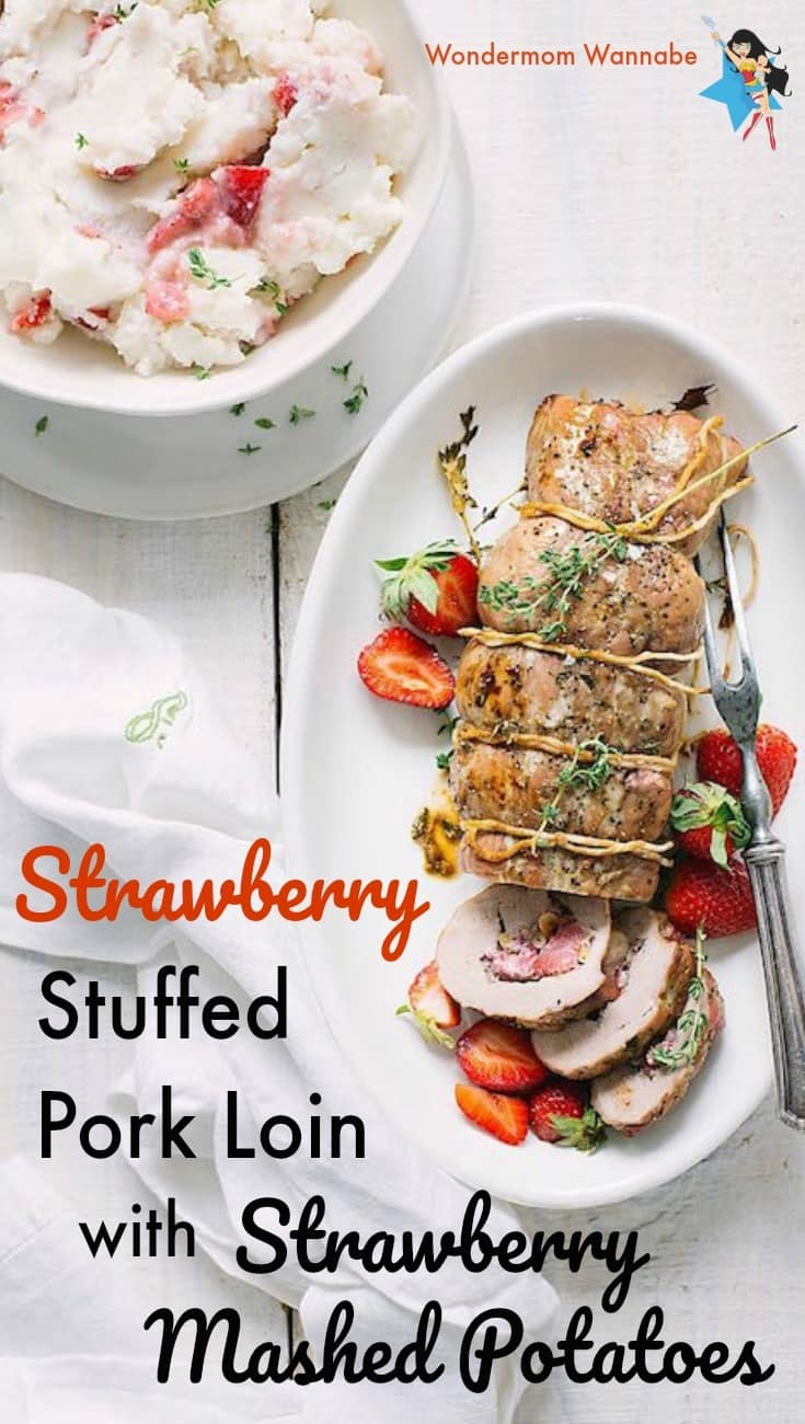 pork loin stuffed with strawberries on  white platter next to strawberry mashed potatoes in a white bowl, all on a white wood table with title text reading Strawberry Stuffed Pork Loin with Strawberry Mashed Potatoes