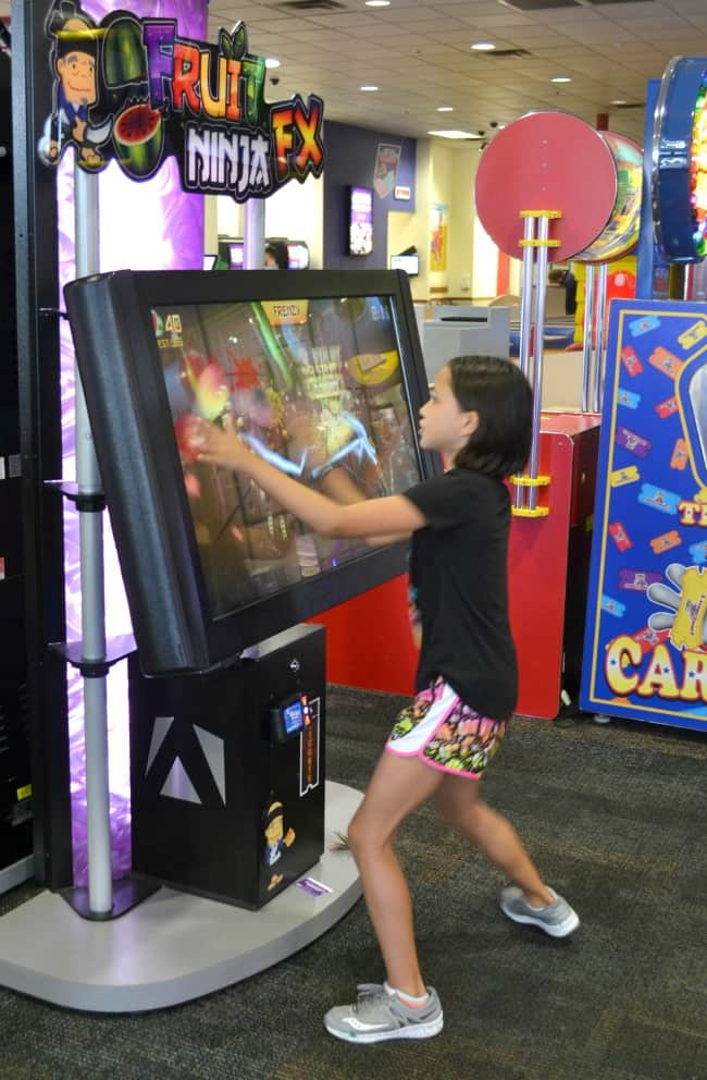 a girl playing at an arcade