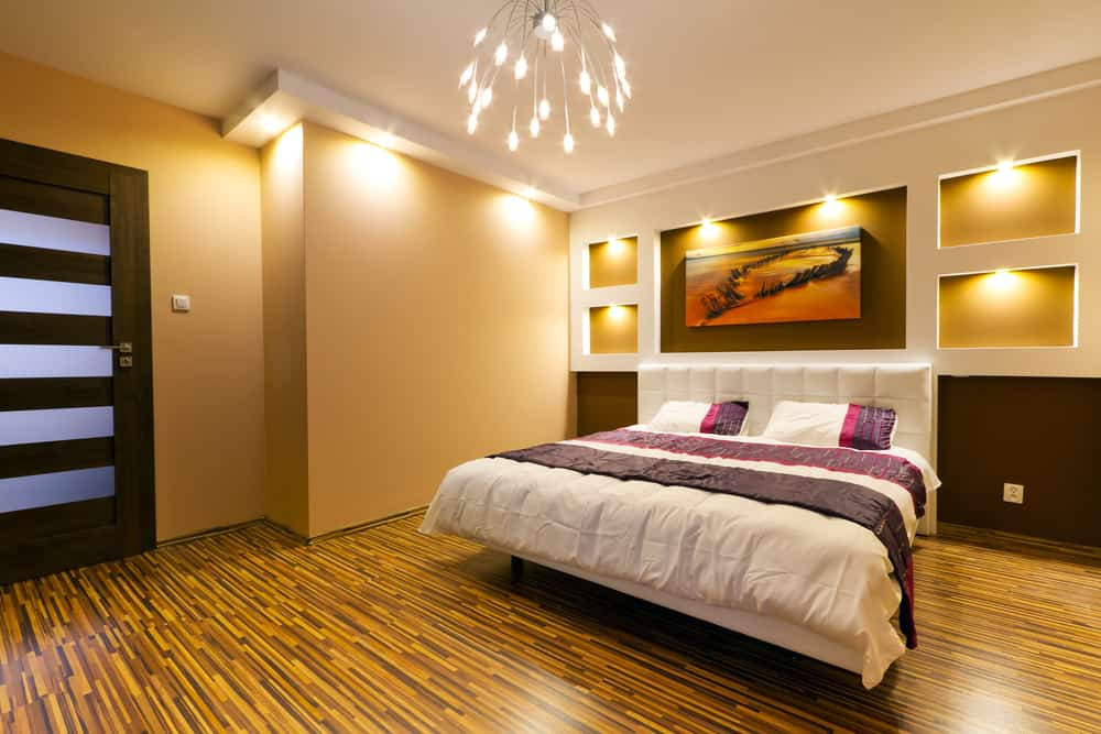 a bedroom with a wood floor decorated with lights