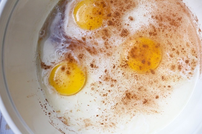milk, cream, cinnamon, vanilla and eggs in a large bowl