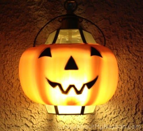 a Halloween pumpkin front porch light