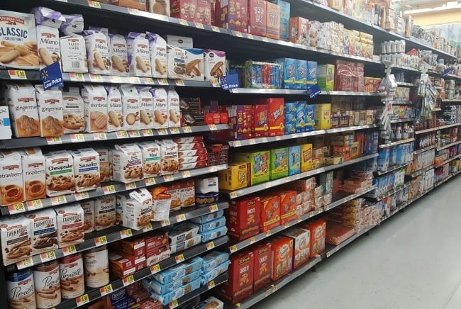 a cookie and cracker aisle in a grocery store
