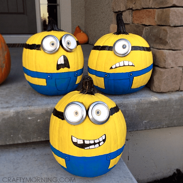 pumpkins decorated to look like minions on a front porch