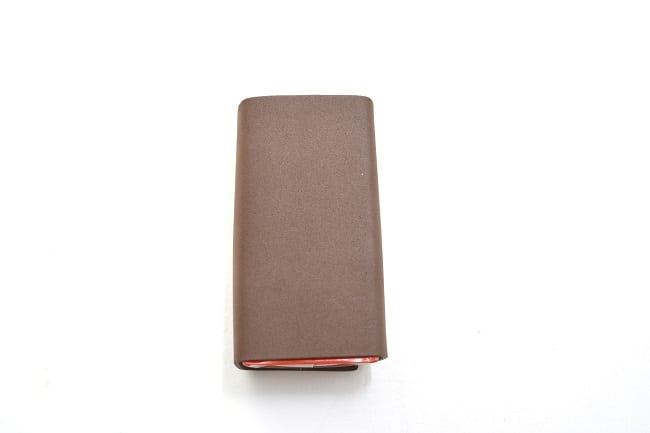 a juice box wrapped in brown craft foam