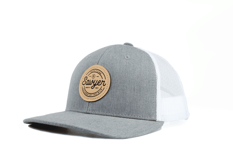 gray and white Sawyer leather patch hat