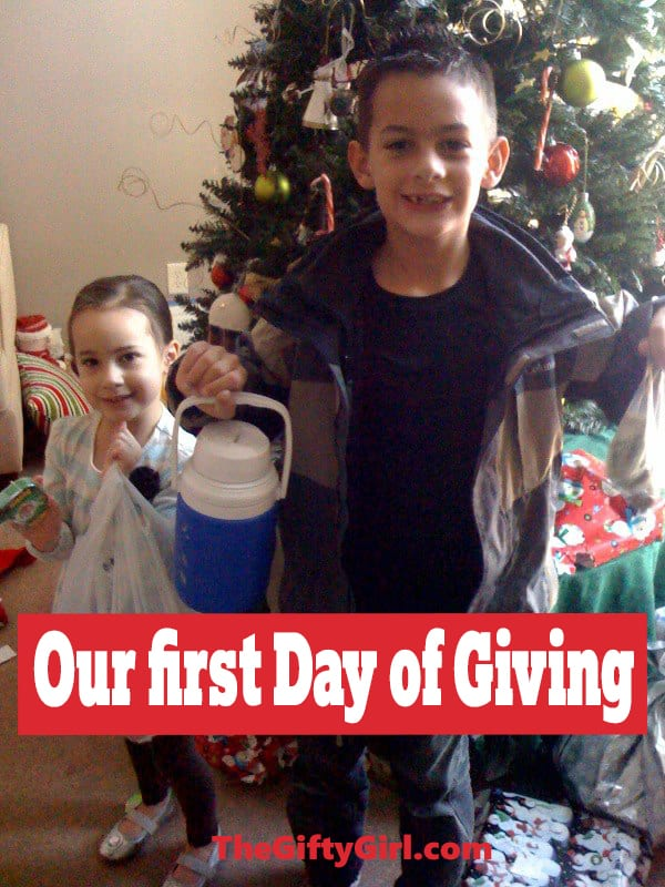 a boy and girl holding a can, a bag and a pitcher in front of a Christmas tree with title text reading Our first Day of Giving