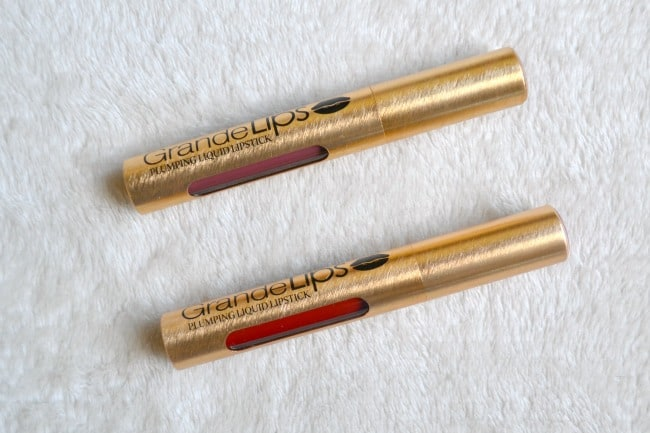 two tubes of Grande Lips lipstick on a white background