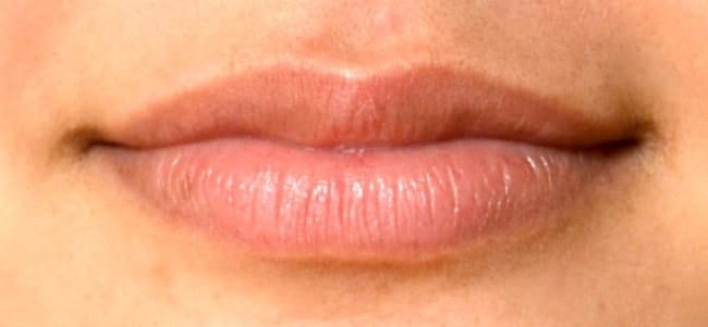 closeup of a girl's lips without lipstick