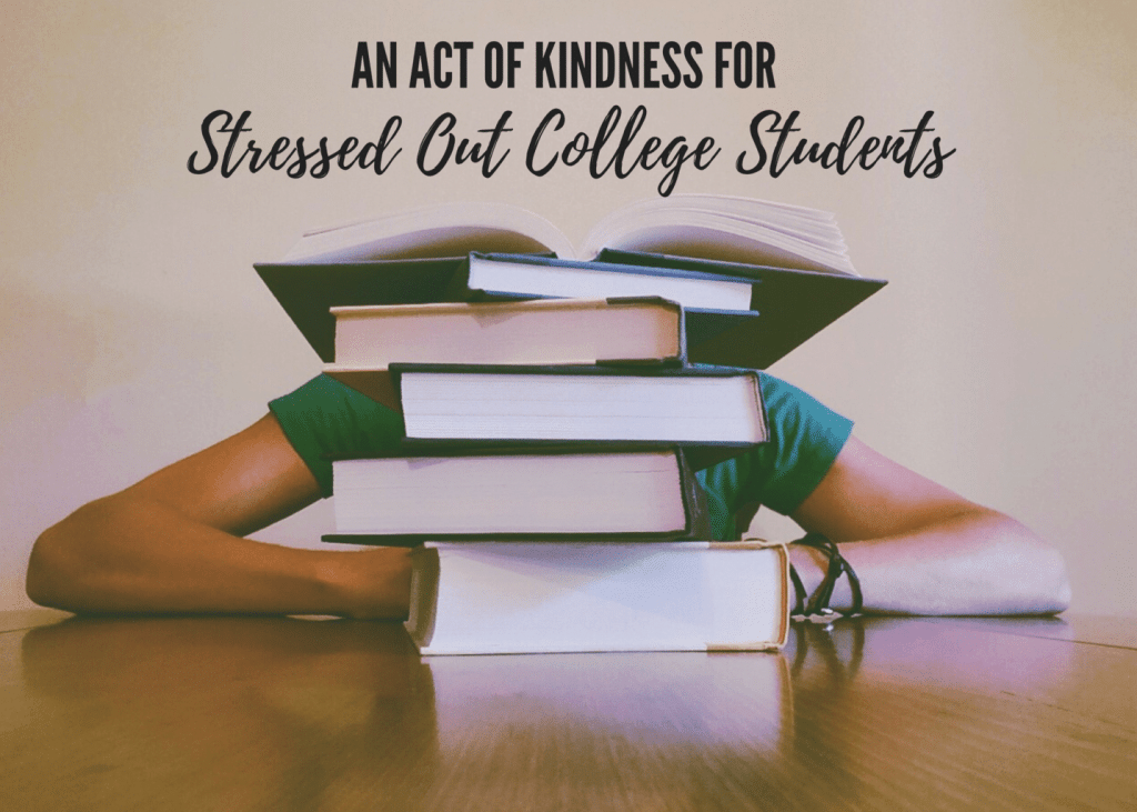 a table with a stack of books on it, taller than the person sitting behind it wit title text reading An Act of Kindness For Stressed Out College Students