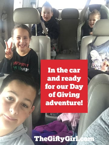 a family in a car with title text reading In the car and ready for our Day of Giving adventure