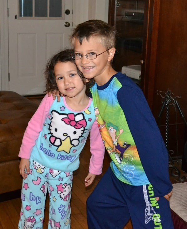 a boy and girl in pajamas