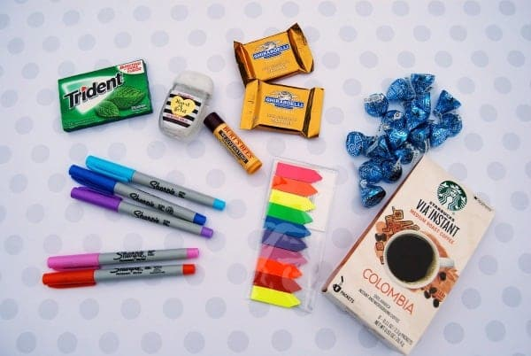 gum, hand sanitizer, chapstick, chocolate, coffee, colored tabs, highlighters on a white background