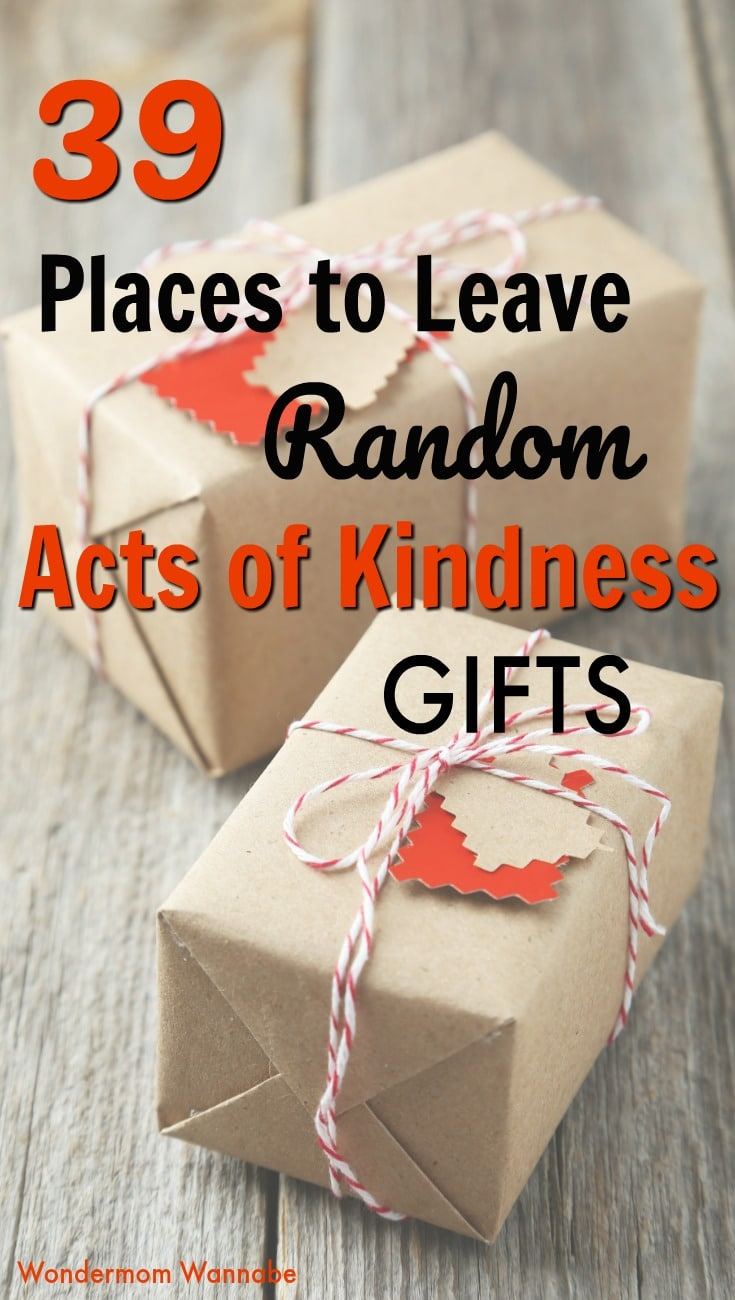 two presents wrapped in brown paper on a wood table with title text reading 39 Places to Leave Random Acts of Kindness Gifts