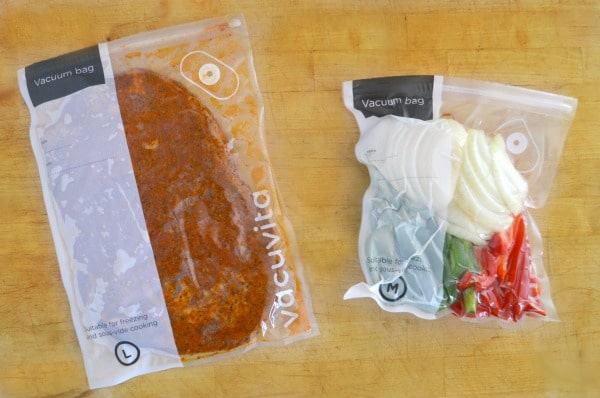 meat and vegetables sealed in vacuum bags