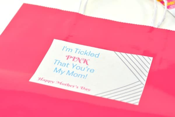 a pink gift bag with a label on it with text reading I'm Tickled Pink That You're My Mom! Happy Mother's Day