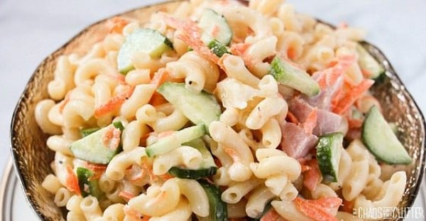 summer pasta salad in a gold bowl