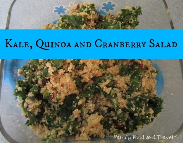 a salad in a glass dish with title text reading Kale, Quinoa and Cranberry Salad