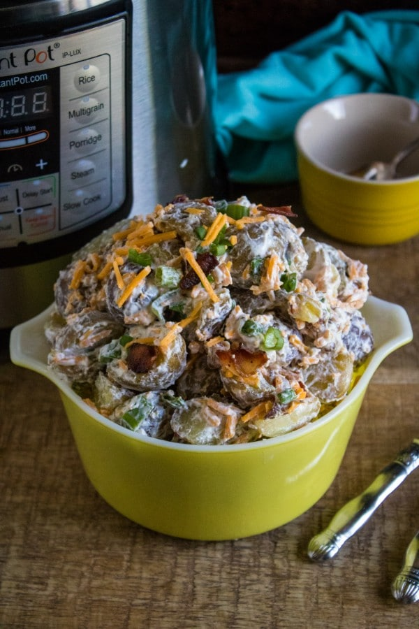 a collage of loaded baked potato salad in a yellow dish next to silverware on a brown wood table with an instant pot, yellow bowl and blue cloth in the background