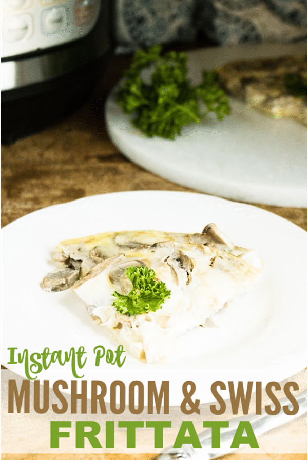 a slice of mushroom and swiss frittata on a white plate on a wood table with the rest of the frittata on a white plate in the background next to an instant pot with title text reading Instant Pot Mushroom and Swiss Frittata