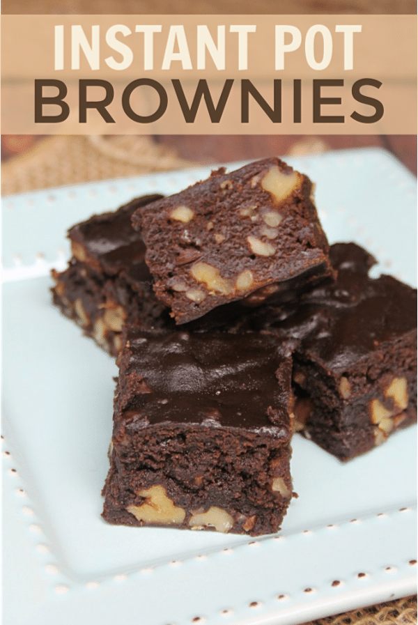 brownies on a white plate on a piece of burlap with title text reading Instant Pot Brownies
