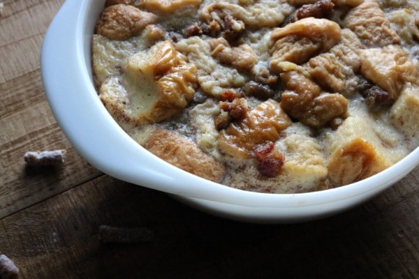 a close up of cooked bread pudding on a table