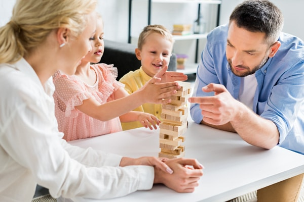 a family playing jenga