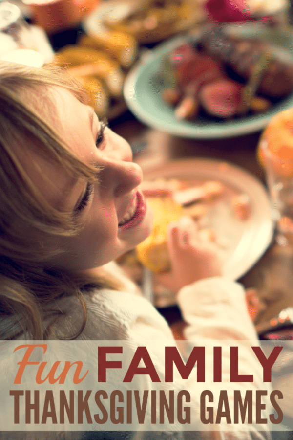 a young girl smiling at someone at a table with lots of Thanksgiving dishes on it with title text reading Fun Family Thanksgiving Games