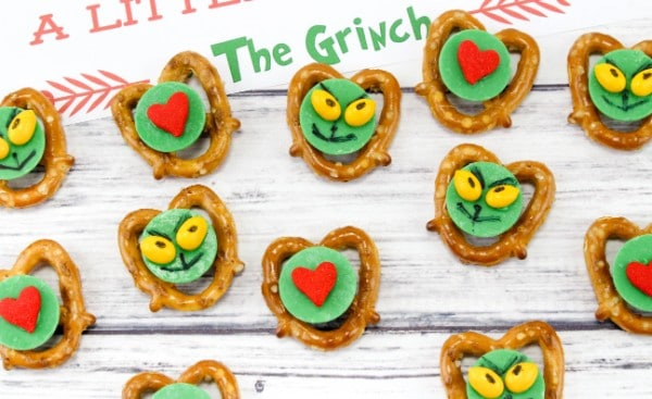 pretzels with a green candy center decorated to look like the grinch or with a red heart on it