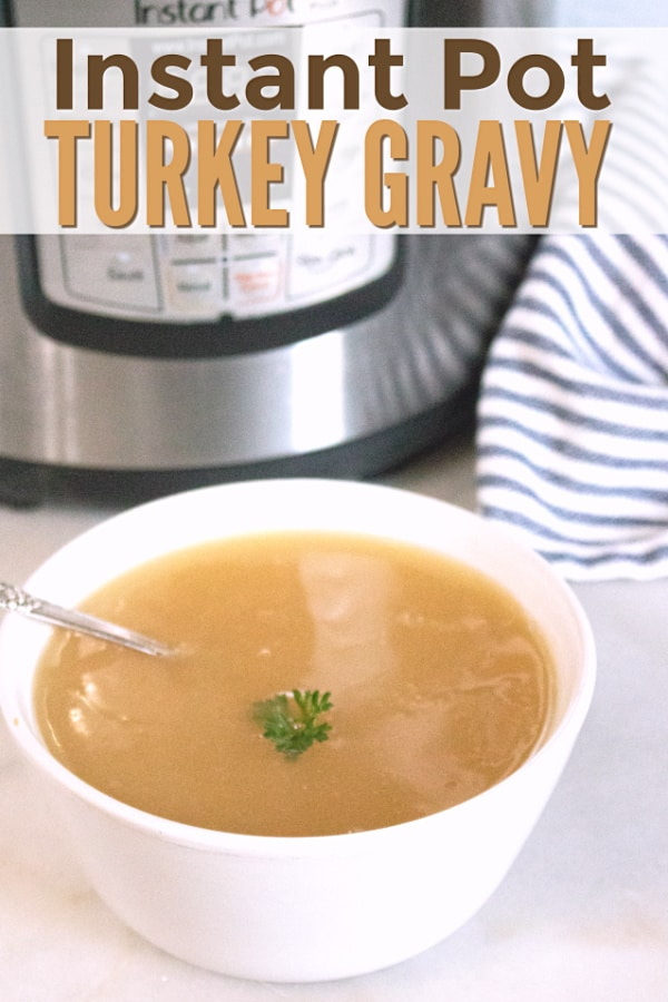 gravy in a white bowl topped with parsley with a spoon in it on a white counter with an instant pot and blue and white linen in the background with title text reading Instant Pot Turkey Gravy
