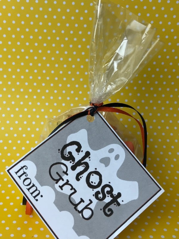 candy in a plastic bag with a label on it with text reading Ghost Grub on a yellow and white polka dot background