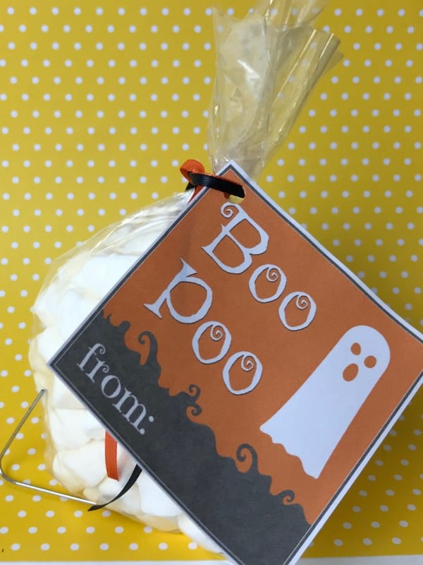 marshmallows in a plastic bag with a label on it with text reading Boo Poo on a yellow and white polka dot background
