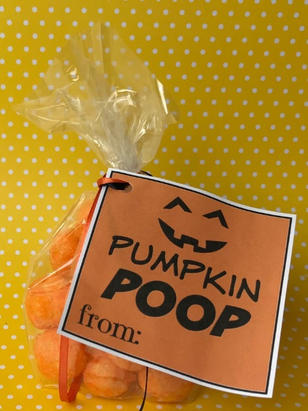 cheese puffs in a plastic bag with a label on it with text reading Pumpkin Poop on a yellow and white polka dot background