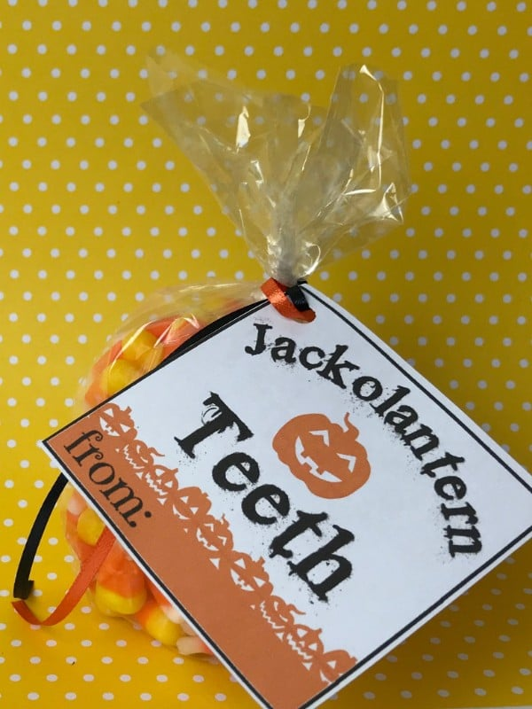 candy corn in a plastic bag with a label on it with text reading Jackolantern teeth on a yellow and white polka dot background